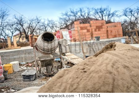 Cement Mixer Machinery Used On Construction Site For Preparing Mortar And Building Brick Walls