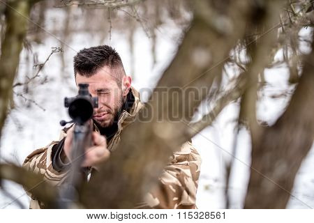 Army Trooper With Sniper On Battlefield, Using Trees As Camouflage