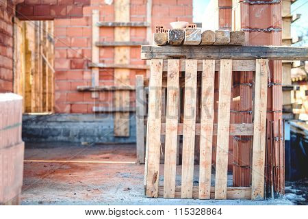 Wall Building And Tools, Bricks And Wooden Blocks On Construction Site