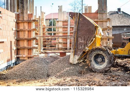 Industrial Truck Unloading Gravel With Excavator And Backhoe On Construction Site