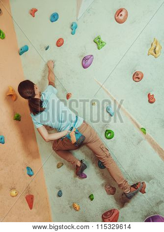 Climber Coating Her Hand In Magnesium