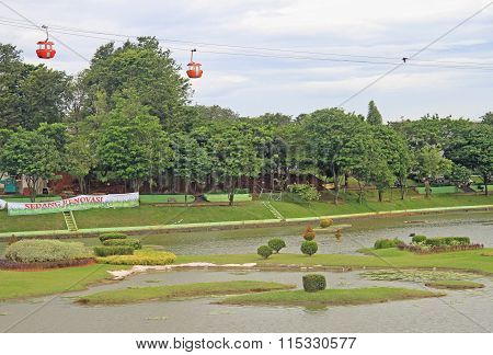 lake with miniatures of indonesian islands in park Taman Mini