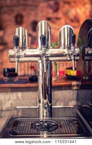 Beer Taps At Restaurant, Bar, Pub Or Bistro. Close-up Details Of Beer Draft Taps In A Row On Barman