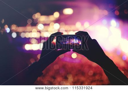Silhouette Of Hands Recording Videos At Music Concert. Pop Music Concert With Lights, Smoke