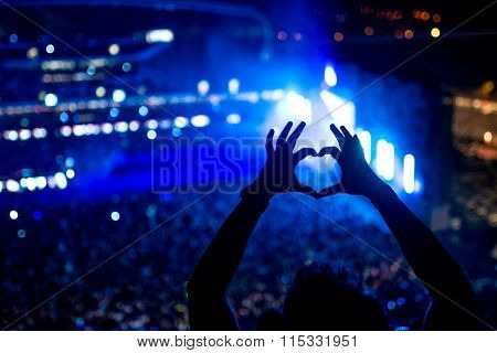 Heart Shaped Hands At Concert, Loving The Artist And The Festival. Music Concert With Lights And Sil