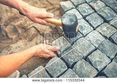 Close-up Of Construction Worker Installing And Laying Pavement Stones On Terrace, Road Or Sidewalk.