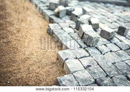 Stone Pavement, Construction Worker Laying Cobblestone Rocks On Sand