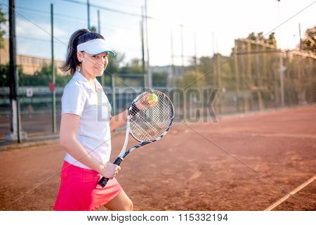 Attractive Brunette Playing Tennis And Smiling At Camera. Healthy Modern Lifestyle With Sportswoman
