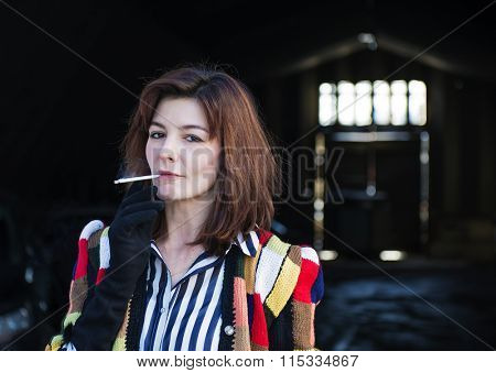 Smoking woman with bright knit sweater. Street Photography