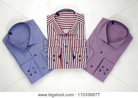 Set classic men shirts on white