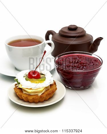 Cake With Fruit, Cranberry Jam, A Cup Of Tea And A Clay Pot On A White Background
