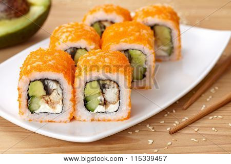 Philadelphia sushi roll with eel, avocado, cream cheese, cucumber and tobiko caviar.