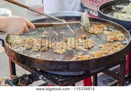 Fried Mussel Pancakes On Frying Pan