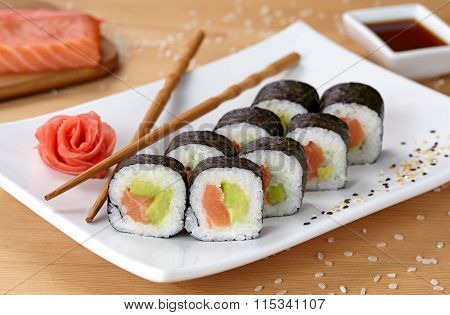 Futomaki sushi roll with salmon, avocado and nori