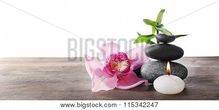 Spa still life with beautiful flower and candlelight on white background