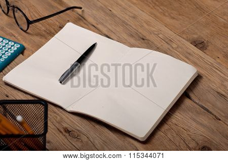 Open Notebook With Pen On The Office Table