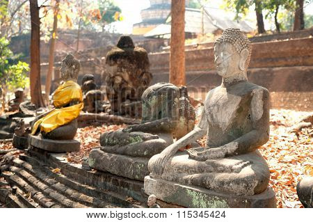 Ancient Outdoor Buddhas In Wat Umong Suan Puthatham.