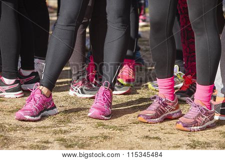 Young Female Athletic Runners Detail Ready To Run. Start Zone