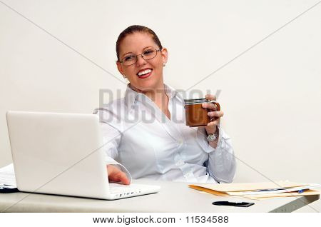 Smiling Young Business Woman with Coffee Cup