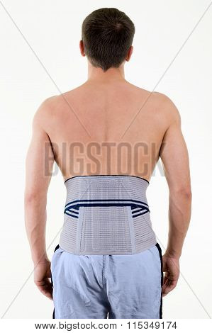 Man Wearing Supportive Brace On Lower Back
