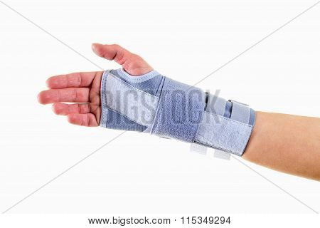 Man Wearing Supportive Wrist Brace In Studio