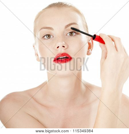 Beautiful Girl Applying Mascara On Her Long Hair - Isolated On White Background.