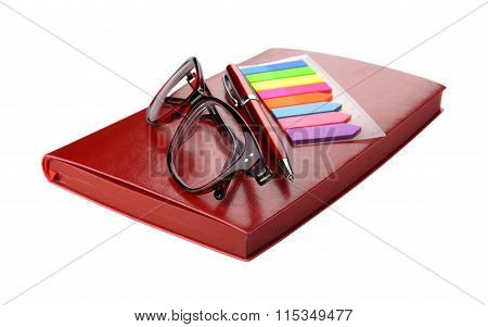 Business still-life of a pen stickers spectacles and diary