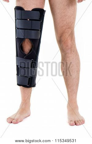Man Wearing Leg Brace In Studio