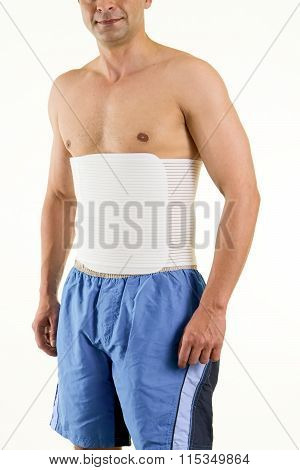 Shirtless Man Wearing Brace To Support Core