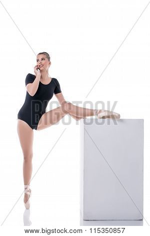 Ballet dancer talking on cellular during rehearsal