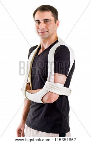 Man With Arm Supported In Sling In White Studio