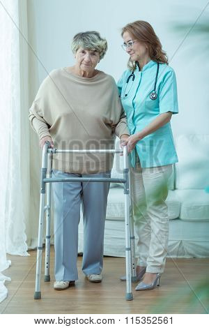 Care Assistant And Old Lady