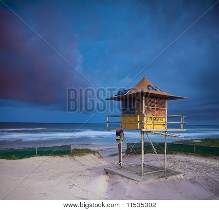 Australian Beach At Twilight With Lifeguard