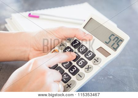 Hands Holding And Press Calculator