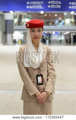 HONG KONG - DECEMBER 26, 2015: Emirates airport staff. Emirates is an airline based in Dubai, United Arab Emirates. It is the largest airline in the Middle East.