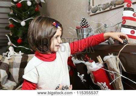 Girl Kid Decorating Home For Christmas