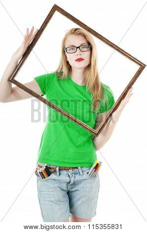 Happy Young Girl With  Colored Pencils, Felt-tip In Pocket  And Holds Empty Frame  From Picture. Gir