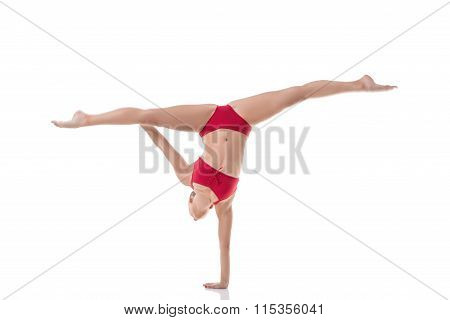 Gymnast performs splits while doing handstand