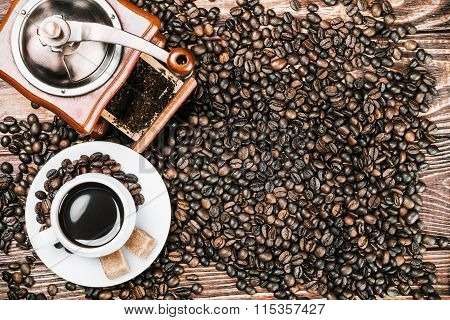 Cup Of Warm Coffee And Coffee Grinder