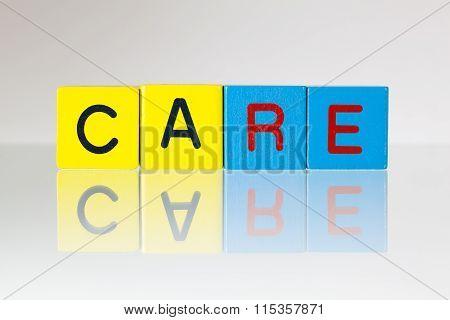 Care - An Inscription From Children's Blocks