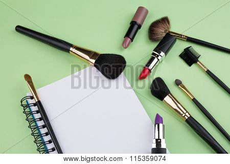 cosmetics makeup and beauty concept green background
