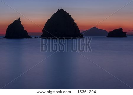 Rocky silhouettes in the sea