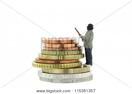 Closeup of Miniature robber model standing on a pile of Euro coins, concept for money robbery