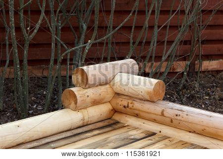 Construction Of Wooden Arbor Made Of Logs