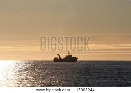 Fishing Trawler On The Horizon
