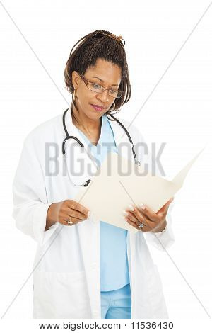 Pretty Doctor Reads Medical Chart