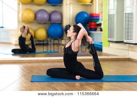 Woman Practicing Yoga Forward Bend Pose
