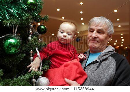 Baby Looking At Christmas Tree