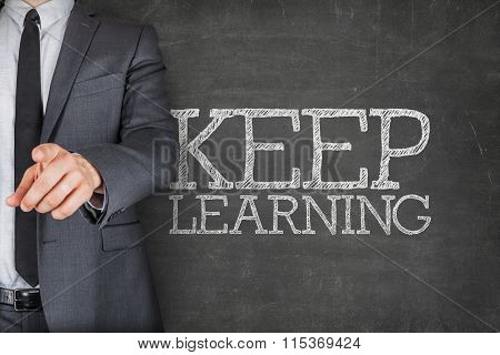 Keep learning on blackboard with businessman