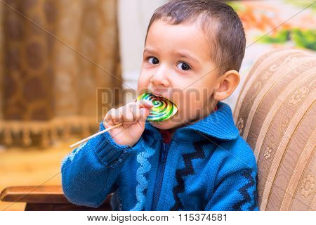 Boy Eating Candy